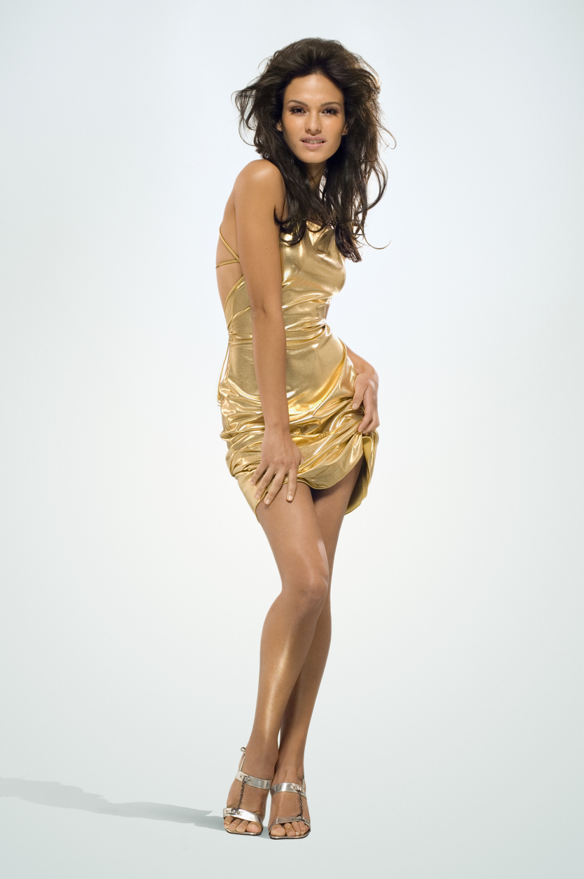 Beautiful woman with hairless legs and shiny dress